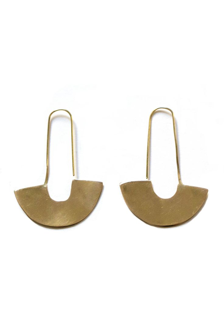 Adisa Earrings from Meyelo's Brass Collection. Handcrafted in Kenya by local artisans. MATERIALS: All materials are raw, up cycled and locally sourced in Kenya. - Hand cast - Brass CARE: Brass may nat