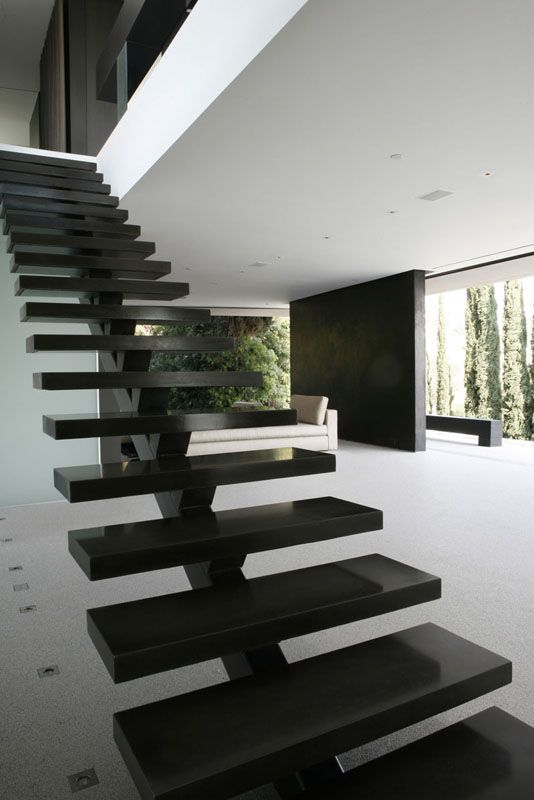 Stair cases can be used to make your home look more modern, this stair case looks more like a piece of art. Openhouse / XTEN Architecture 345851061_openhouse-004a – ArchDaily