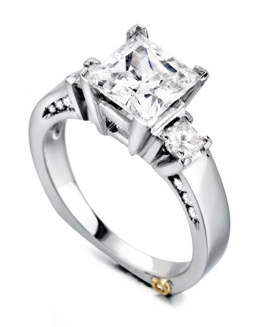 The Alluring engagement ring contains 14 diamonds, totaling 0.445 ctw. Center stone sold separately, not included in price.The Alluring wedding band contains 8 diamonds, totaling 0.37ctw.