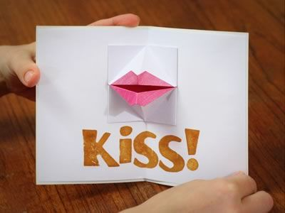 kissing lips origami valentine card.  Has a tutorial and directions