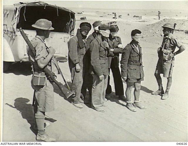 TOBRUK, LIBYA. 1941. BLINDFOLDED ITALIAN PRISONERS OF WAR BEING BROUGHT INTO THE FORTRESS AREA, TOBRUK. Pin by Paolo Marzioli