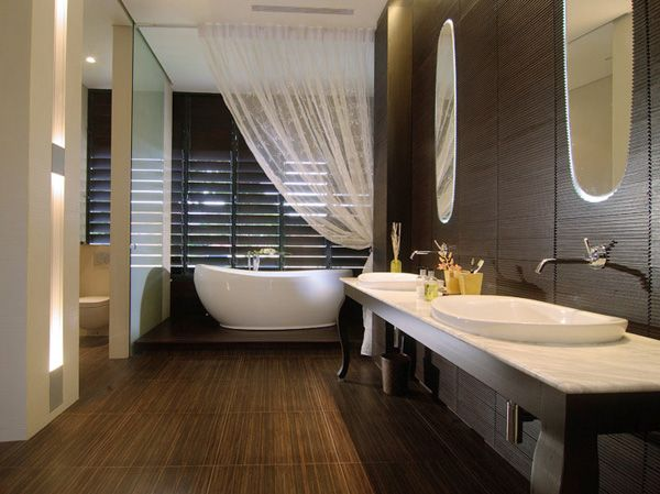 Spa bathroom with wooden style-twi sinks and mirrors with a white bathtub completed with awhite curtain and lights from the ventilations