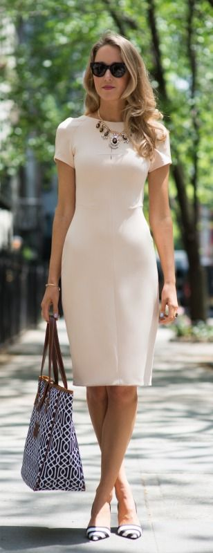 Nude and black, always looks elegant. The neat neckline and short sleeves keep the look professional.