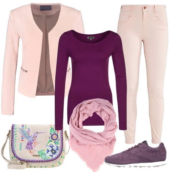 Un delicatissimo rosa pastello è il colore dei pantaloni e della giacca, da abbinare ad una maglia basic viola. Le scarpe sono delle sneakers sempre viola, mentre la borsa, in una tonalità chiara, ha soggetti primaverili. Un foulard di colore pastello completa la composizione.