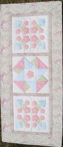 Somerset Table Runner is $5 as a downloadable pattern.  This pretty pastel runner uses simple piecing and applique techniques.