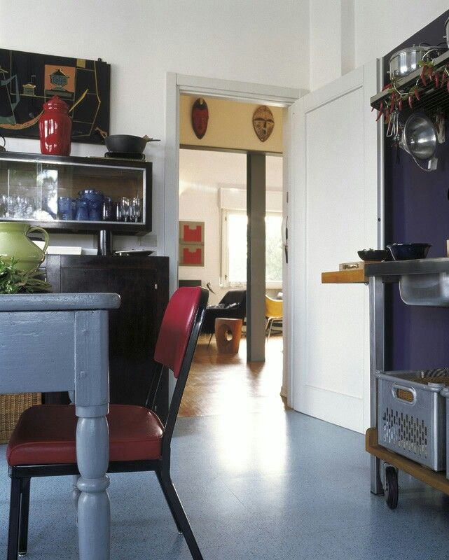Viareggio house. Soft industrial kitchen. '800 lucchese table;'50 italian kitchen side board; africans mask. marcoinnocentiarchitetto.