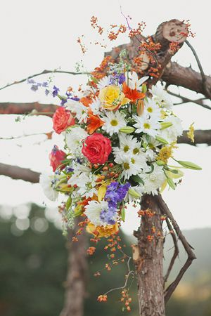 Wildflower bouquet ceremony arbor for bohemian style wedding #boho #bohowedding
