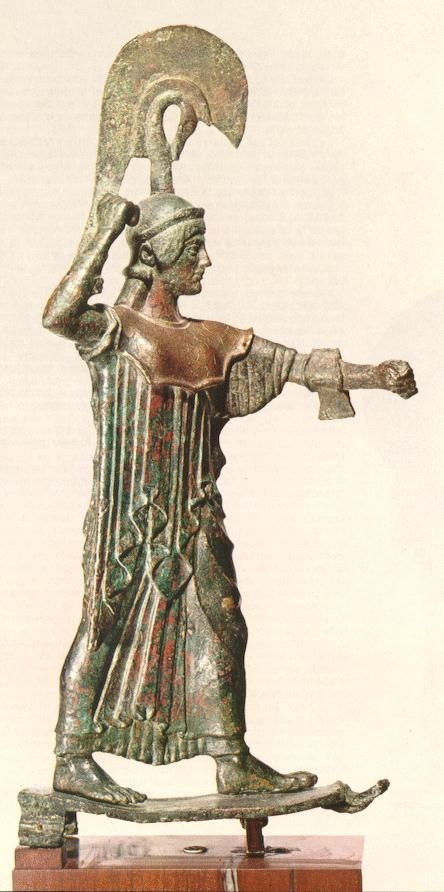 5th C. BCE. Athena Promachos version of 566 BCE statue erected by archon Hippocleides during the Panathenaial.  The top of the Attic helmet is derived from the motif of the swan neck. The long Aegis (back shield) reveals the curve of the Goddess's back would have been covered in gold leaf. The severe face places this work about 470 BCE. 2 dresses under the himation pleaten to the knees: Archaic dress pleats in vogue in Official works of the time  Athens, Nat'l Archaeological Museum