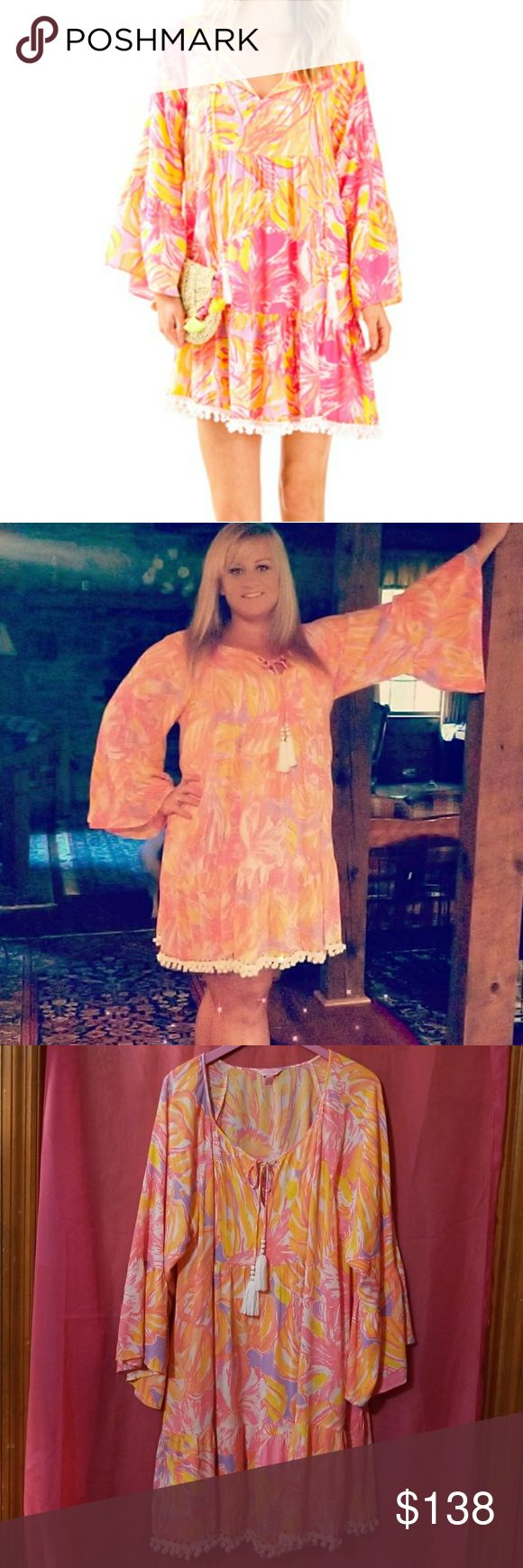 "Lilly Pulitzer Amisa tunic dress Pre-owned Multi sun Splashed  Notch Neck Tunic Dress With Bell Sleeves And Beaded Hemline With Pom Pom Details. 35 1/2"" From Top Of Shoulder To Hem. Length: Above The Knee. Crinkle Viscose Gauze (100% Rayon).  Gorgeous Dress!  Flattering on everyone! Some of the beads on the hemline are missing as shown in last 2 pictures Lilly Pulitzer Dresses Long Sleeve"
