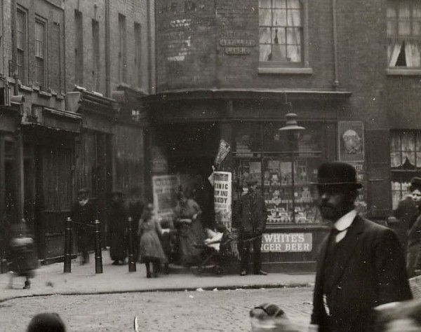 On a blog post about pictures taken in 1912 around Spitalfields: you can see newshoarding announcing the sinking of the Titanic, confirming the date of this photograph as 1912.