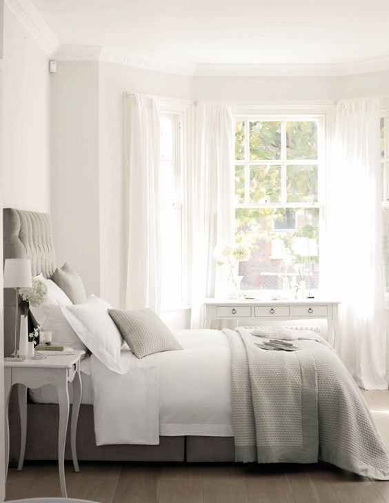 The White Company bedding. Love the colours - so neutral. The window and white curtains look amazing and add light to the room.