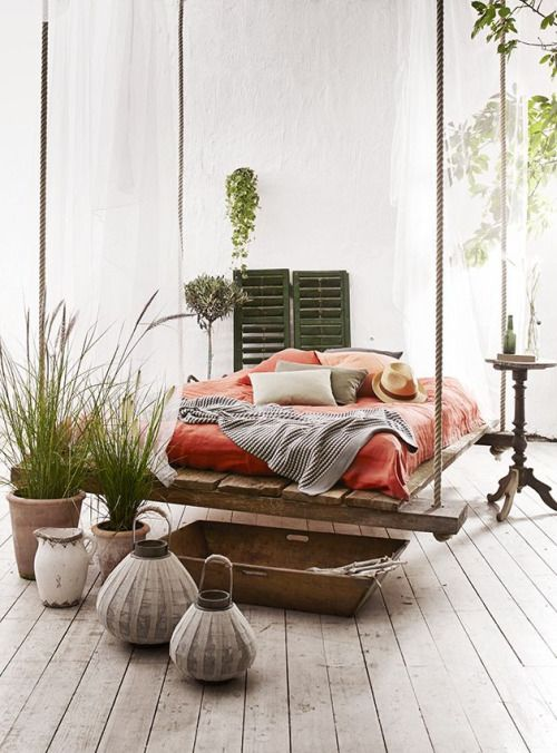 """""I love how the bed is suspended from the ceiling creating a swing effect."""""