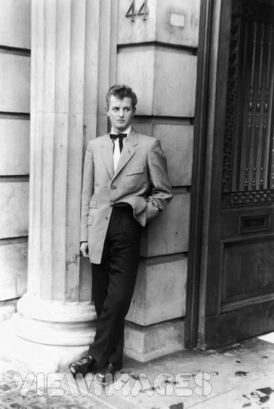 late 1940s and 1950s, Britain; Teddy boys - longer jackets with more shaping, high turned back lapels, cuffed sleeves, waistcoat, narrow trouser