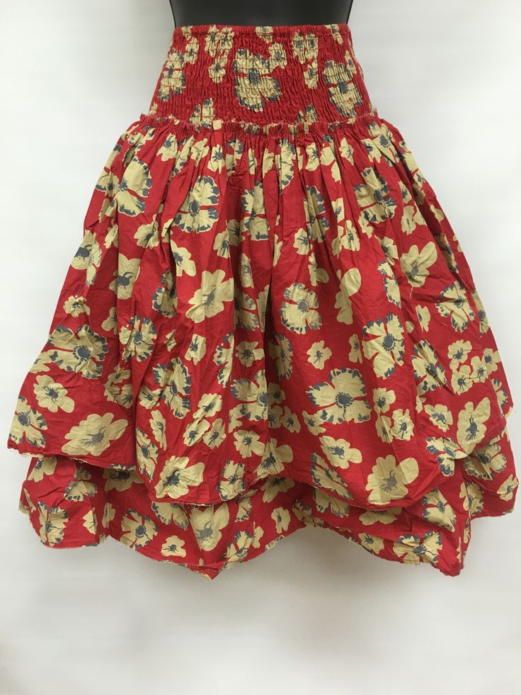 Made in Sweden Multi layers Ewa I Walla skirt. 100 % cotton. Elastic wide waist line.The color is red with flowers is muted yellow and grey.