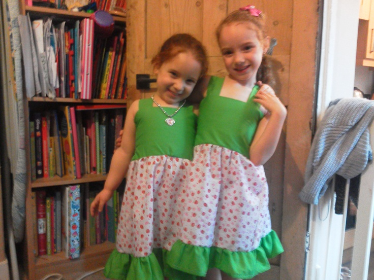 My girls wearing their dresses I made for them