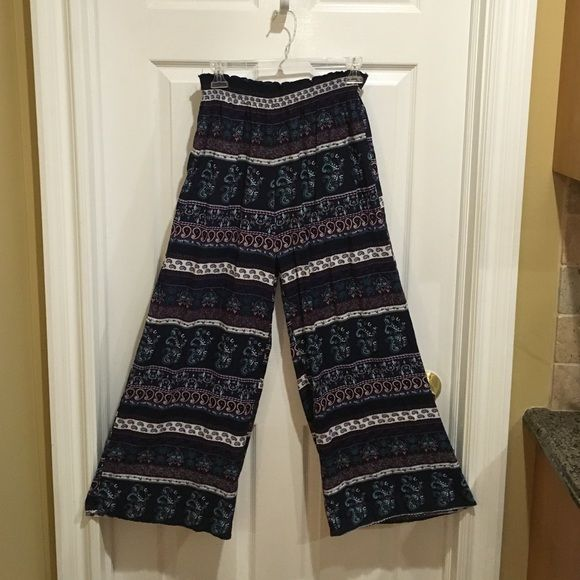 Garage Clothing Hippie Pants Elastic cinched waste with wide bottoms. Super comfortable bottoms with a beautiful pattern for a fun going out outfit! Garage Co. Pants