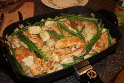 Lemon Pepper Chicken with Artichokes, Mushrooms and Asparagus in electric skillet. ~
