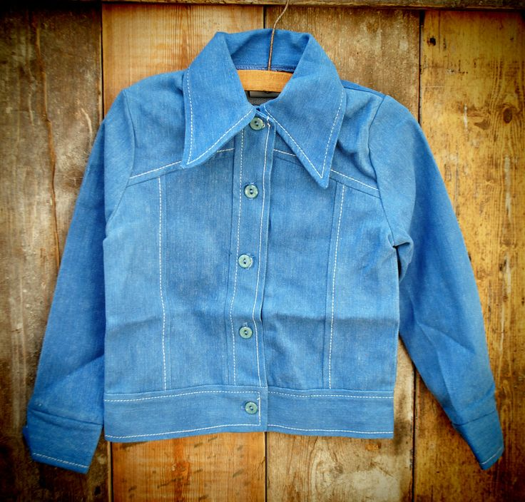 1970S DENIM JACKET  18.00 Unworn 1970s unisex denim jacket with white stitching age 5-6 years  Lovely and soft denim jacket with white stitching and pointed collar. This jacket is so darn cool.