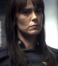 """Admiral Helena Cain of """"Battlestar Galactica: Razor."""" She ran a tight ship in a time of war during an Extinction Level Event. Channeled by Michelle Forbes."""