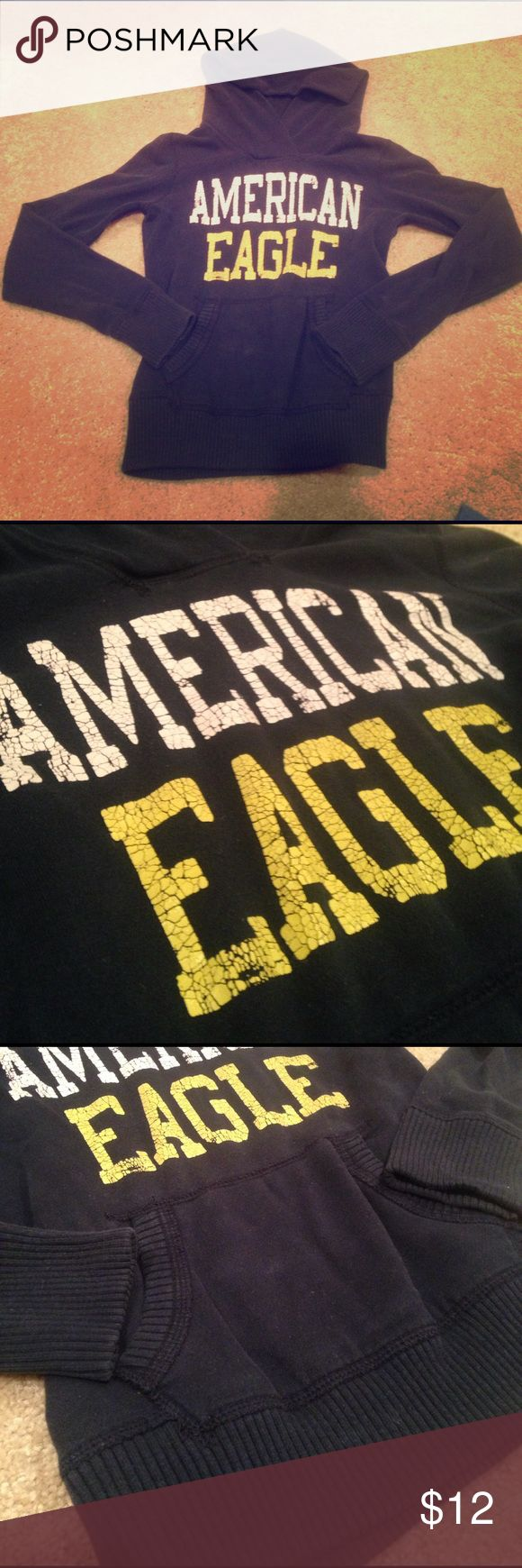 American Eagle pullover hoodie Pre loved. Dark blue with yellow and white writing. Some fading and cracking in the writing as shown in photos. Thick and cozy. Big hood. Love AE hoodies ☺️ American Eagle Outfitters Sweaters