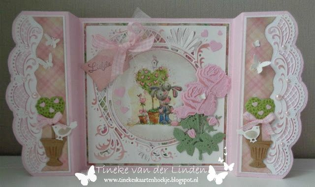 Handmade card by DT member Tineke with among others Creatables Tiny's Rose (LR0451), Anja's Circle XL (LR0445), Petra's Beautiful Border XL (LR0407), Craftables Punch Die Butterflies (CR1354), Punch Die Hearts (CR1322) and Topiary Set (CR1303) from Marianne Design