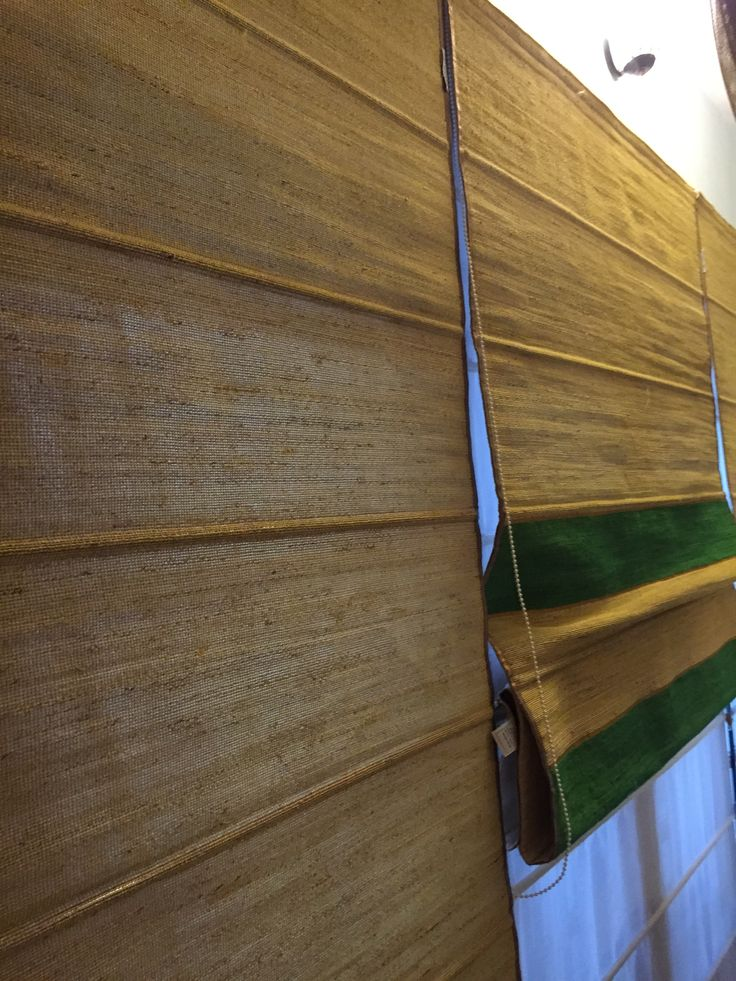 Banana fibre & emerald green dyed hibiscus Roman blinds add charm to this trapezoidal shaped room
