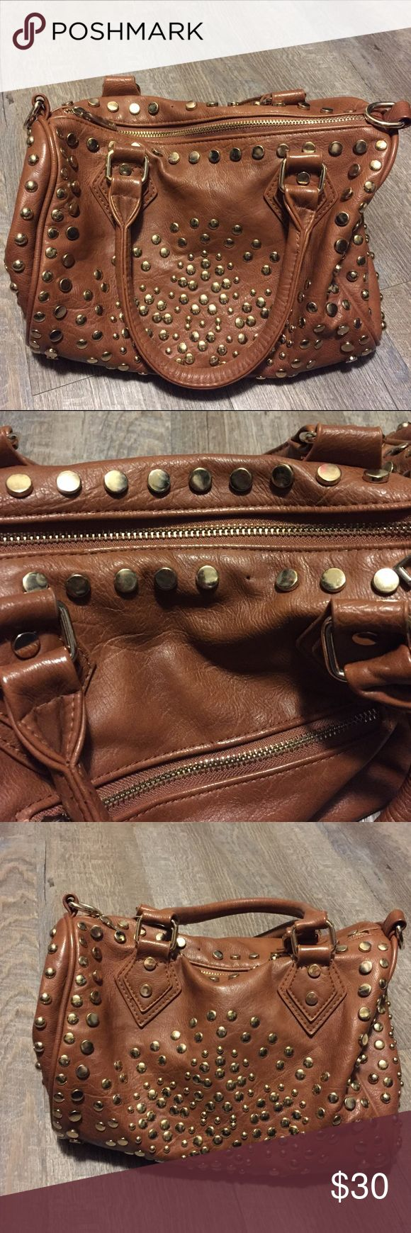 Medium sized brown studded handbag Medium sized brown studded handbag. Studs are gold, super cute bag. Has cross body strap and is included. There is one stud missing from the top and is shown in picture 2. Pre loved in great condition! No trades, please make offers through offer button. MMS Bags Shoulder Bags