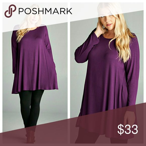 Deep Purple Long Sleeve Tunic Tunic is a deep purple and fabric has a very fine texture (French terry).  Soft and swingy, slips overhead. Tops