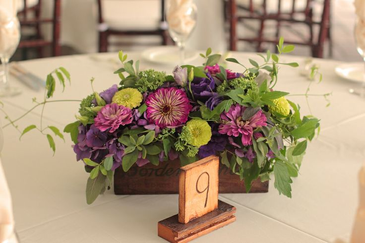 Brightly colored August centerpiece in a vintage wooden cheese box.
