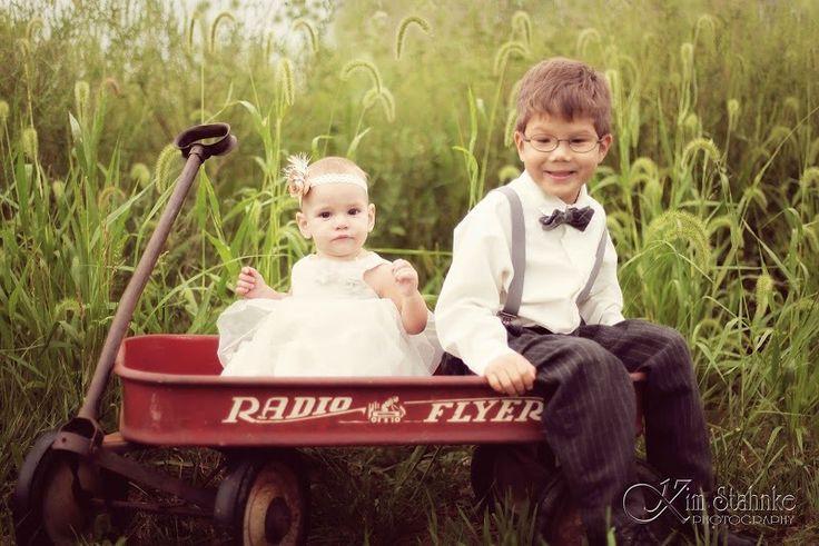 Flower girl and ring bearer in wagon