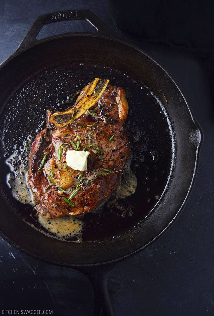 Pan-seared ribeye steak recipe cooked in garlic, butter, and fresh rosemary and topped with blue cheese compound butter.