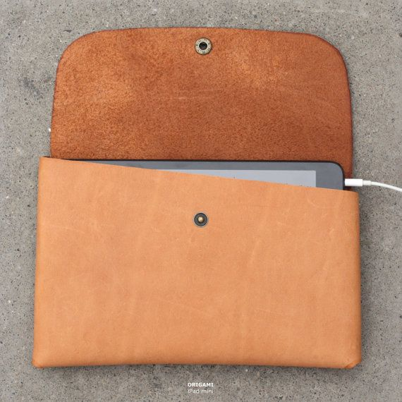 Buy Now & Get 2 USB Organizers FREE >    The ORIGAMI iPad case is folded from one piece of leather with metal snap buttons, so it can be