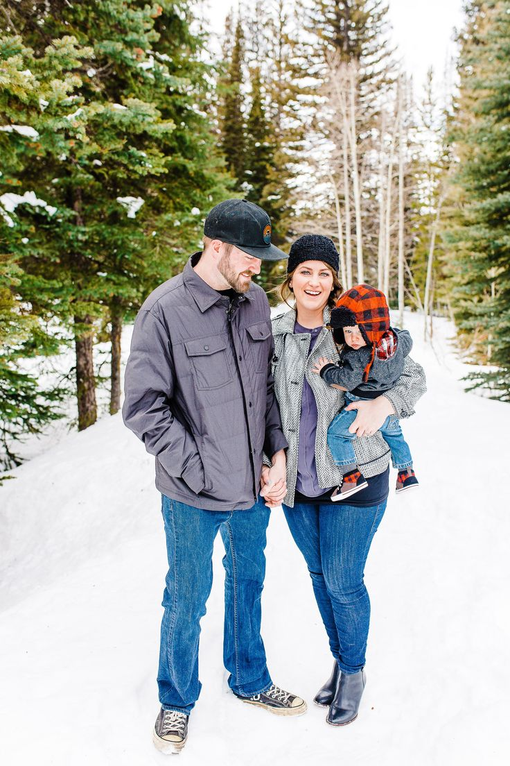 Snowy Family Pictures | Utah Family Photographer | snow pictures | what to wear for family pictures | cute family pictures poses | candid family poses | snowy pictures | family of 3 picture ideas | what to wear for snowy pictures | I'd love to work with you! Please contact me to book your session!