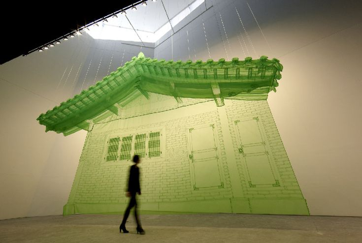 korean artist do ho suh's work showcases sculptural pieces of hread-and-sheer-fabric investigate  the idea of truly inhabiting a place, developing the concept of 'home' as skeletal representations,  actualizing this concept as both a boundary and passageway in the gallery space.