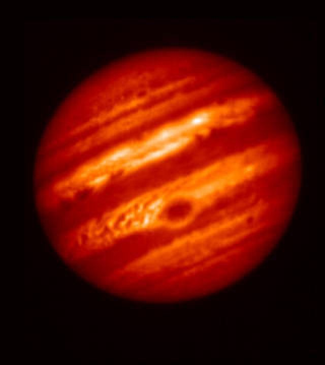 This false-color image comes from the Subaru Telescope in Hawaii, taken using a mid-infrared filter on May 18. (That's a longer wavelength than that used for the above Gemini photo, taken the same night.) The Great Red Spot appears as a cold region with a thick layer of clouds.