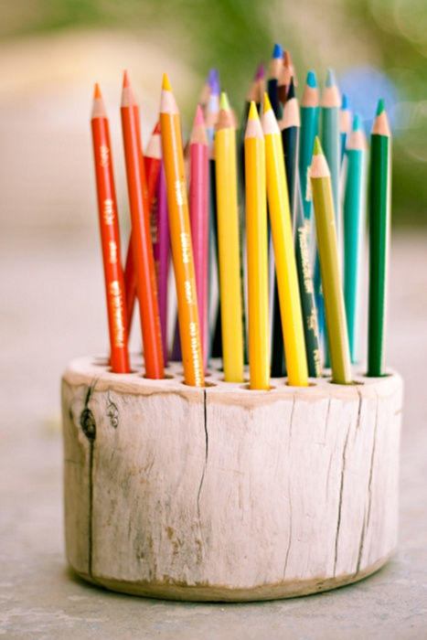 dannaklein:    Rustic Pencil Holder - the perfect, and potentially free summer DIY project. Find a piece of wood, sand it down, drill holes for the pencil spots, and either paint it with a simple clear finish or a spray paint in whatever color your heart desires. I'm personally a fan of this simple wood look.