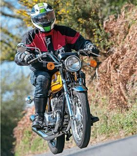 Stylish and with amazing street presence : The Kawasaki S1A. Kawasaki's Triple Ride & Review