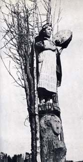 "Joan Halifax writes of this picture: ""A female machi (shaman) has ascended her rewe or notched pole.  The pole has steps, and the machi climbs to the seventh level to complete her skyward journey.  She plays a frame drum that assists her in her climb up the World Tree.  In the Mapuche region of Chile, the hallucinogens Anadenathera, Datura, and Brugmancia were used during shamanic seances."""