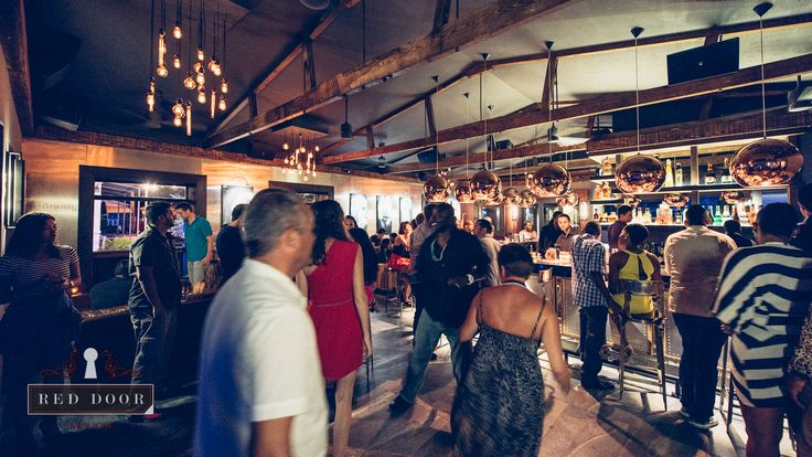 Want to party in Barbados? Head to the islands' premier nightlife hideaway in Holetown's trendy Second Street - Red Door Lounge