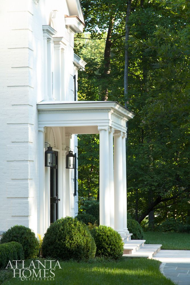 William B. Litchfield added architectural details that strengthen this Buckhead house's Georgian presence, including a portico.