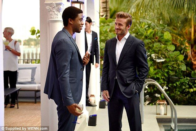 Dapper: David Beckham suited up for his big night, looking dashing in a suit and white shirt as he chatted to guests