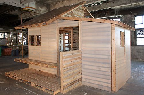 Pallet House, composed of 100 shipping pallets -- a 500-square-foot bungalow -- cool #palletecture