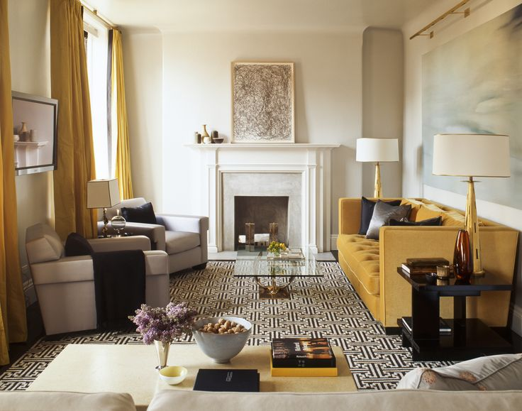 Steven Gambrel | A bold mustard yellow sofa is a great option for a warmer and more inviting living room. It looks beautiful paired with whites and nudes. #modernsofas #velvetsofa