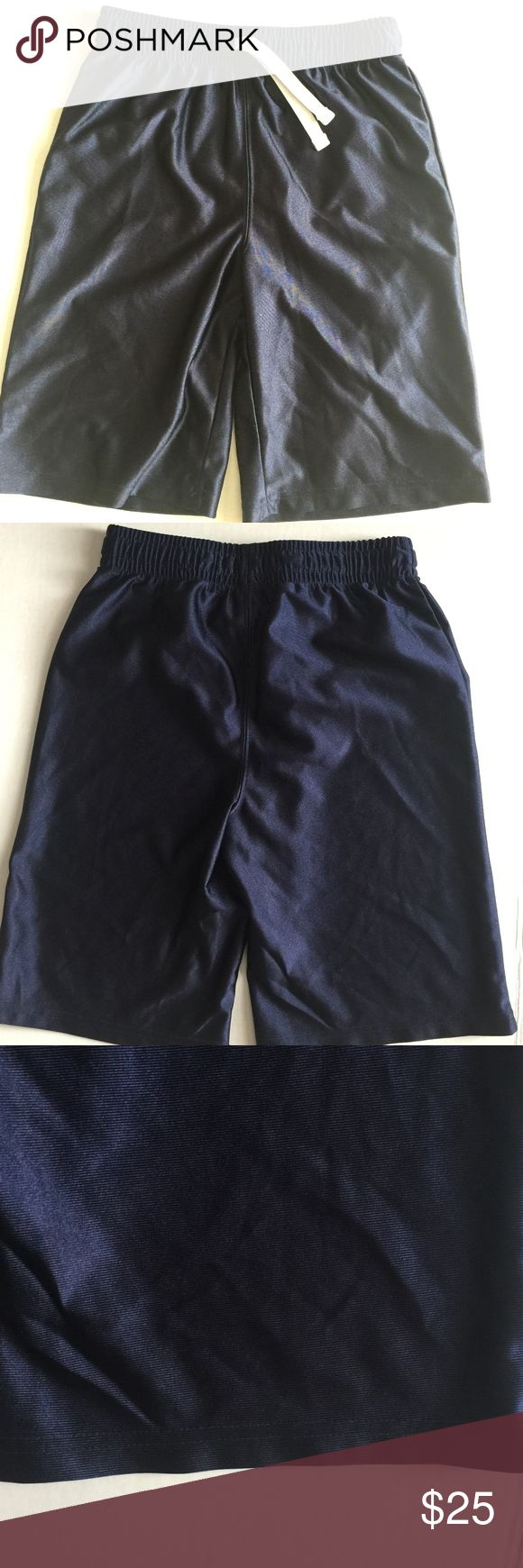 """Boys Children's Place Navy Basketball Shorts Boys Children's Place Navy Basketball Shorts Size Large   •Size: L (10/12) •Waist: 22"""" •Front rise: 10"""" (high rise) •Back rise: 12.5"""" •Length: 18.3"""" •Inseam: 9"""" •Leg opening (lying flat): 9.3"""" •In very good condition •From a smoke-free and pet-free home •Reasonable offers accepted Children's Place Bottoms Shorts"""