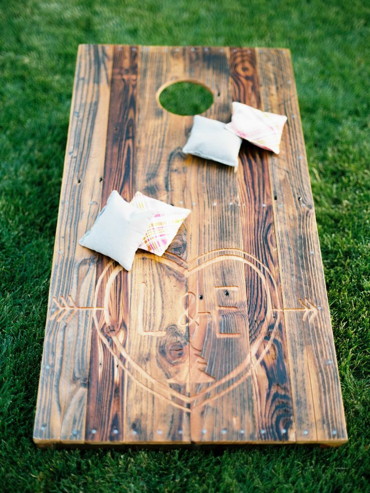 Outdoor Lawn Games during Cocktail Hour |  LOVE the corn hole boards