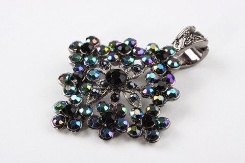 Bohemian Flowers Enhancer: A Bohemian style flower pendant, encrusted with coloured rhinestones and finished with a magnetic clasp. This feminine vintage styled piece radiates romance. Can be added to a variety of chains and beads $59.90