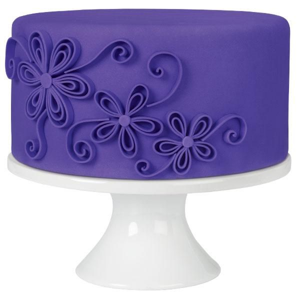 Quilled Flowers Purple Fondant Cake - Combine the trendy look of quilling with easy-to-work-with Wilton Decorator Preferred Purple Fondant for a modern cake. Learn how to quill with fondant and you will be able to make fabulous flowers, freeform designs and so much more.
