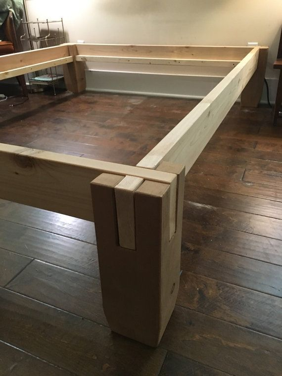notched cedar timbers easily stack together with no tools to make a solid bed