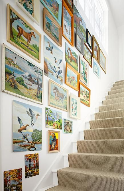 Paint by numbers are a great vintage item to collect. Each one is unique based on who painted it. I love the way these are displayed along a stairway!