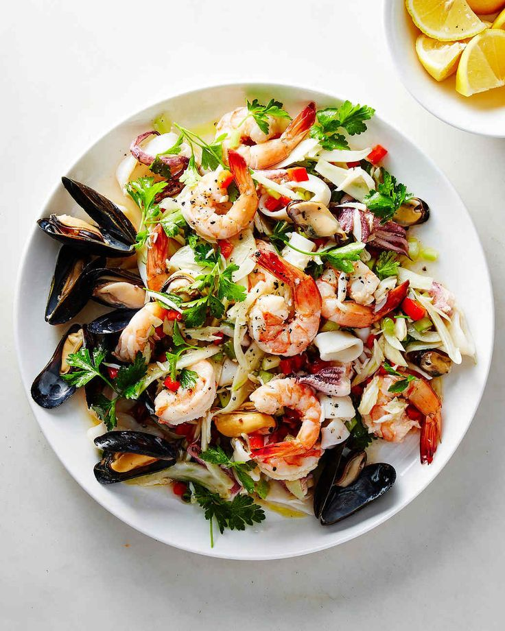 Seafood is a must for the Feast of the Seven Fishes, an Italian Christmas Eve tradition. This salad with squid, shrimp, mussels, and crab is a delicious way to kick off the meal.